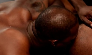 Hunky black couple assfucking after foreplay