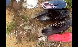 boy pissing on old shoes