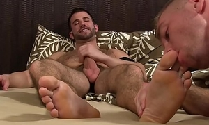Bearded hunk wanks off while being feet worshiped and sucked