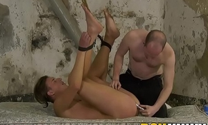Restrained Casper Ellis anus pressed with cock and fucktoys