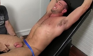 Tied up jock receives cock tickling from a freaky guy