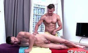 Cute twink gets a lusty massage from arresting gay alms-man