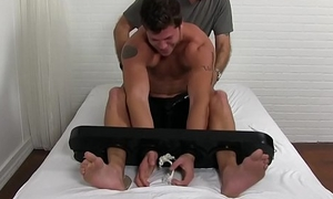 Good looking hunk hogtied and tickled by a perverted man