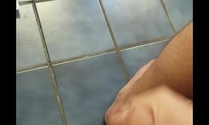 Chubby guy cums on go to the powder-room floor