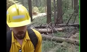 Lumberjack wanking outdoors.