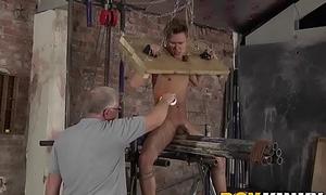 Beautiful young sub endures hot wax and strong handjob