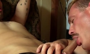 Attractive gay man sits down and fucks lovers mouth wildly