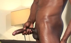 Athletic stud strokes his massive black dong