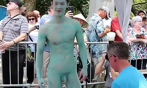 Naked Asian Lad'_s body is painted in public