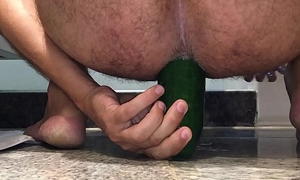 Riding a huge cucumber surrounding my ass pussy