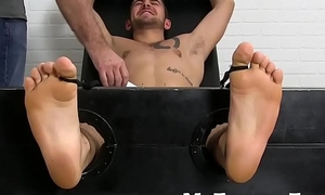 Two guys have freaky feet mime a tied up happy-go-lucky stud