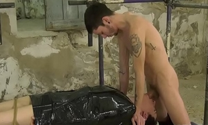 Wrapped up twink gets his cute face fucked by huge dick