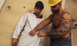 Tattooed construction worker screws handsome youngster