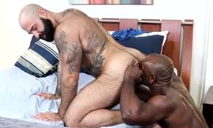 Horny black dude fucks his bearded boyfriend in confines