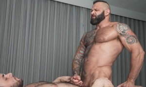 Two muscled bears pleasuring each other in verge upon